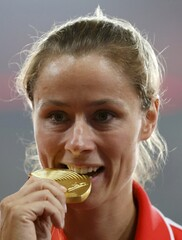 Molitor of Germany, gold medal, poses on the podium after the women's javelin throw event during the 15th IAAF World Championships at the National Stadium in Beijing