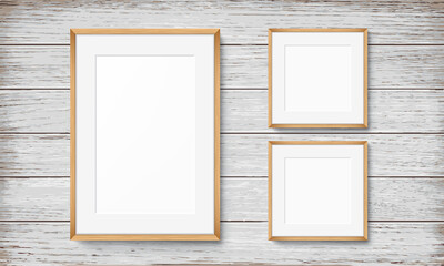 Set of frames on wooden background