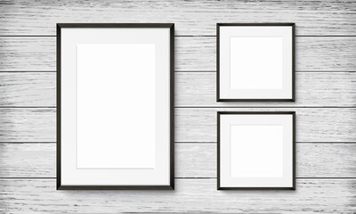 Set of black frames on wooden background