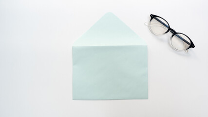 Office desk table with  envelope and glasses close up Top view copy space