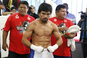 Boxer Manny Pacquiao poses after working out ahead of his bout with Tim Bradley, in Hollywood