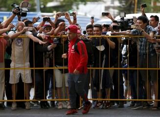 Chile's national soccer team player Gary Medel is cheered by fans after arriving at the Sheraton hotel in Montevideo