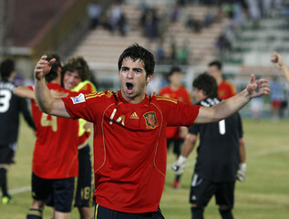 Spain's Jordi Amat celebrates after winning the penalty shootout