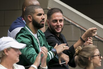 Rapper Drake watches as Williams of the U.S. plays Italy's Vinci in their women's singles semi-final match at the U.S. Open Championships tennis tournament in New York