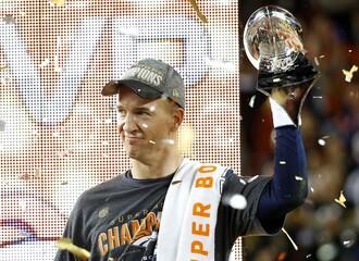 Denver Broncos' quarterback Peyton Manning holds trophy after Super Bowl 50 football game in Santa Clara