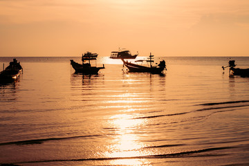 silhouette long tail boat at sunset,Koh Tao,Thailand