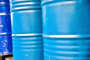Close-Up View of Blue Industrial Chemical Drums