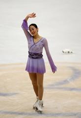 Mao Asada of team Japan waves as she competes at the ladies free skating program during China ISU Grand Prix of Figure Skating, in Beijing
