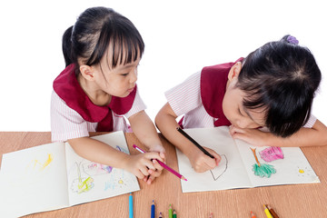 Asian Little Chinese girls drawing with color pencils