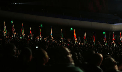 Women carry national flags during the opening ceremony of the 66th FIFA Congress in Mexico City