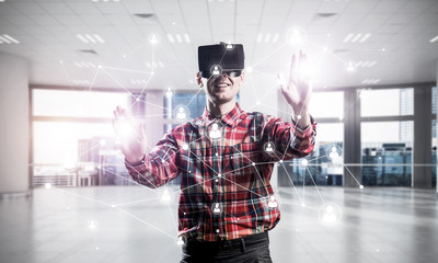Guy wearing checked shirt and virtual mask reaching hand to touc