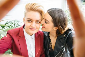 Gentle lesbian couple posing
