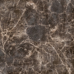Close up of abstract artificial rock texture. Imitation brown marble.
