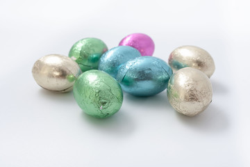 Multi-colored easter chocolate eggs in colored foil