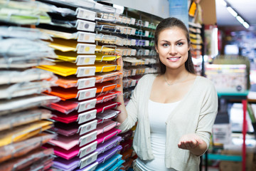 Customer picking multicolored paper