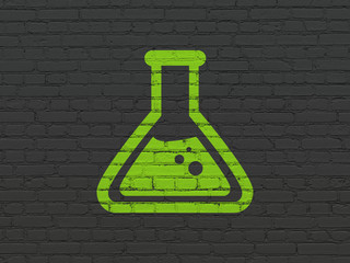Science concept: Flask on wall background