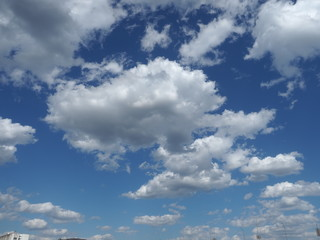 Deep blue sky and white clouds.