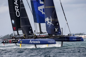 AC45F racing sailboat Artemis Racing powers ahead of Oracle Team USA during race 2 on their way to winning the America's Cup World Series sailing competition on the Great Sound in Hamilton