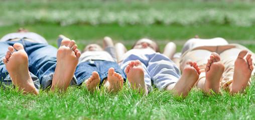 Family feet on grass