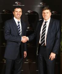 (L-R) Gary Speed with Jaguar Managing Director Geoff Cousins