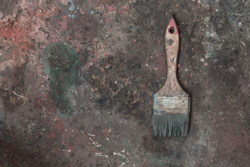 Abstract background of old dried paint, paint brush, oil paint