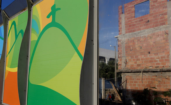 Banners advertising the 2016 Rio Olympics are seen near the Mare slums complex of the Linha Vermelha freeway connecting Rio de Janeiro's International Airport with Rio de Janeiro's downtown and south zone