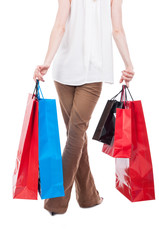 Back view of shopping woman carrying gift bags