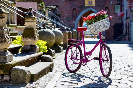 pink bike on an old street