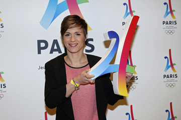 French basketball star Celine Dumerc holds the logo as she attends the presentation of the Paris candidacy for the 2024 Olympic and Paralympic Games in Paris