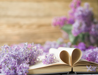 Opened book on the table with pages like heart and flowers