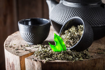 Fresh green tea with iron teapot and cup