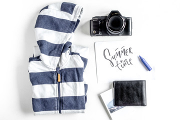 children tourism outfit with clothes and camera on white background flat lay