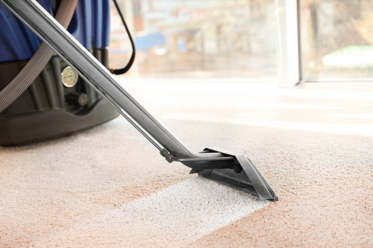Steam vapor cleaner removing dirt from carpet in flat