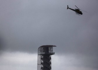 Rain clouds approach as a helicopter flies past the tower at the U.S. F1 Grand Prix at the Circuit of The Americas in Austin, Texas
