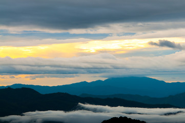 Landscape of sunrise and foggy over the mountain.