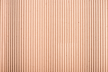 Close-up top view of blank brown striped cardboard texture