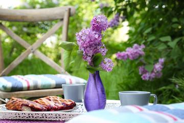 Breakfast in beautiful lilac garden