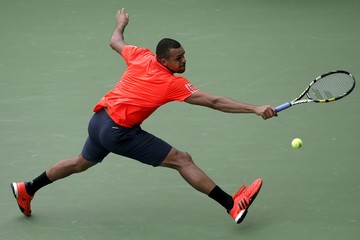 Jo-Wilfried Tsonga  of France hits a return to Sergiy Stakhovsky of Ukraine during their match at the U.S. Open Championships tennis tournament in New York