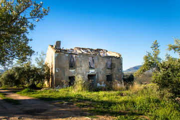 Old, left and damaged farmhouse in Andalusia, Spain on a day in spring