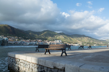 Touristic and vacation pearl of Sicily, benches en small town of Cefalu, Sicily, south Italy