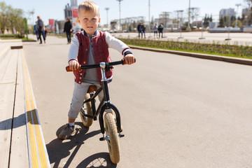 Small boy on run bicycle