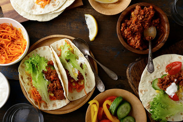 Mexican food - delicious Tacos with ground beef and vegetables