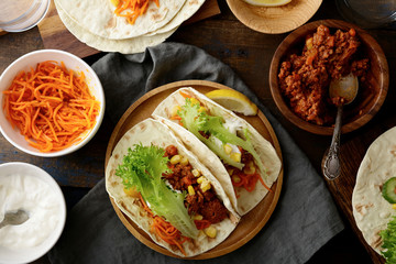 Two Mexican Tacos with ground meat and different ingredients
