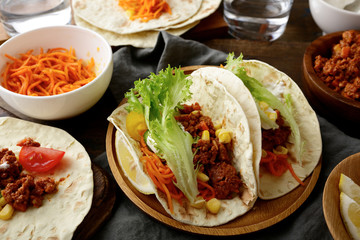 Mexican food - tasty Tacos with ground beef and vegetables
