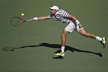 Jeremy Chardy of France lunges for the ball hit by Marin Cilic of Croatia during their fourth round match at the U.S. Open Championships tennis tournament in New York