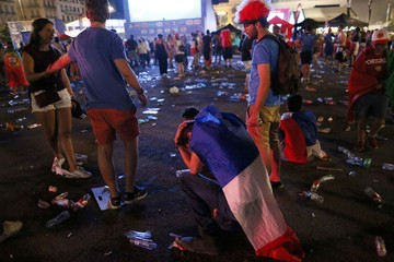 France fans react after their loss at Lyon fan zone during a EURO 2016 final soccer match