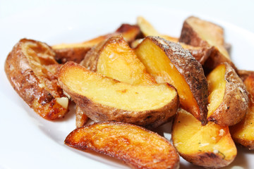 Potato wedges roasted in their skins