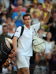 Andy Murray of Great Britain waves to the crowd after winning his second round match