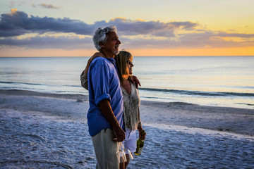 Active retirees enjoy the sunset on Siesta Key beach FL
