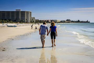 Two people taking a walk along Siesta Key Beach FL